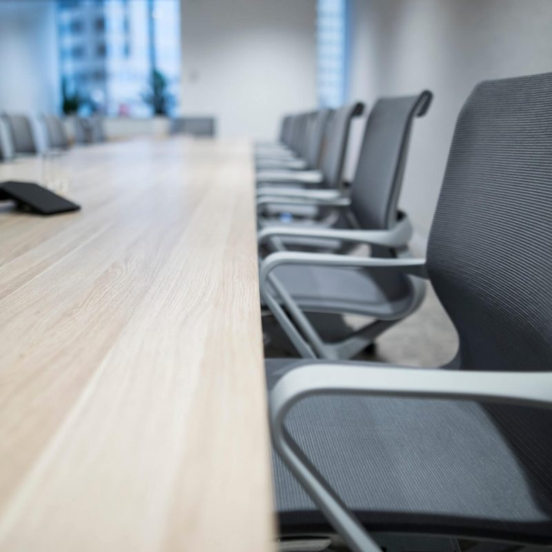 view-of-a-long-board-room-table-with-chairs-against-the-window-which-has-a-view-of-the-sydney-office_t20_kob6Ep.jpg